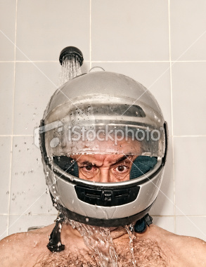 Men with helmet in shower