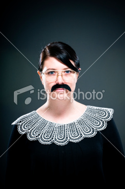 Young adult woman with blue eyes and mustache