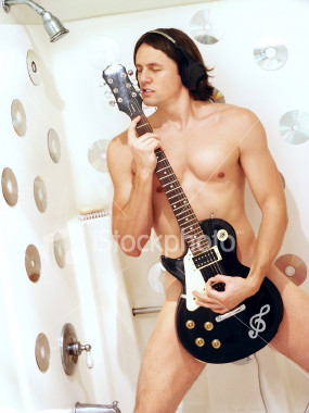Naked Man Playing Guitar in Shower