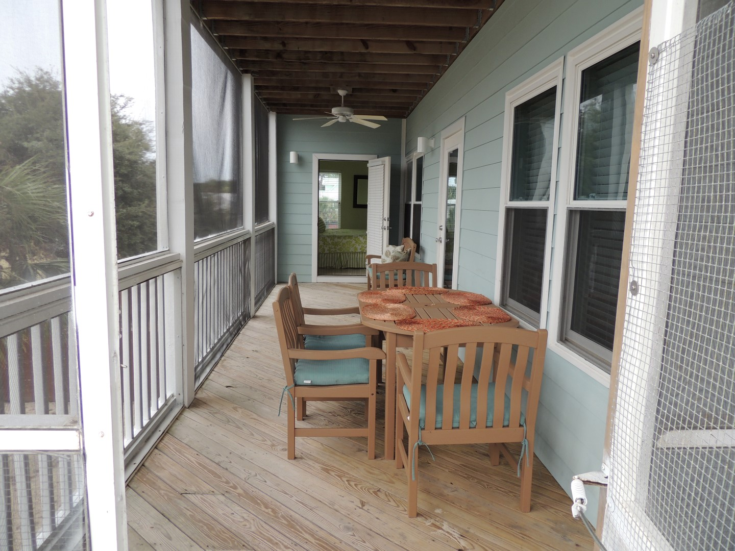 Two Palms-Screened in Deck off Main Floor-Kitchen- With BDR Access- Facing Gulf of Mexico-2