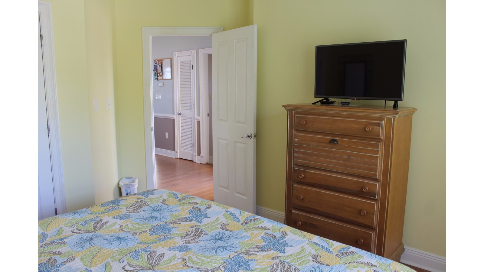 Yellow BedRoom, King Mattress, Main Floor, Bathroom Attached, TV and Closet. Facing Road and Nature Preserve