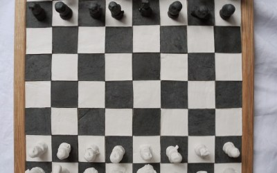 Chess board with owls in black and white porcelain
