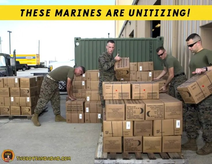 Marines stacking boxes into groups.