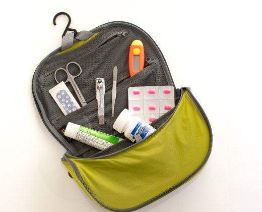 A travel first aid kit opened to show the contents inside
