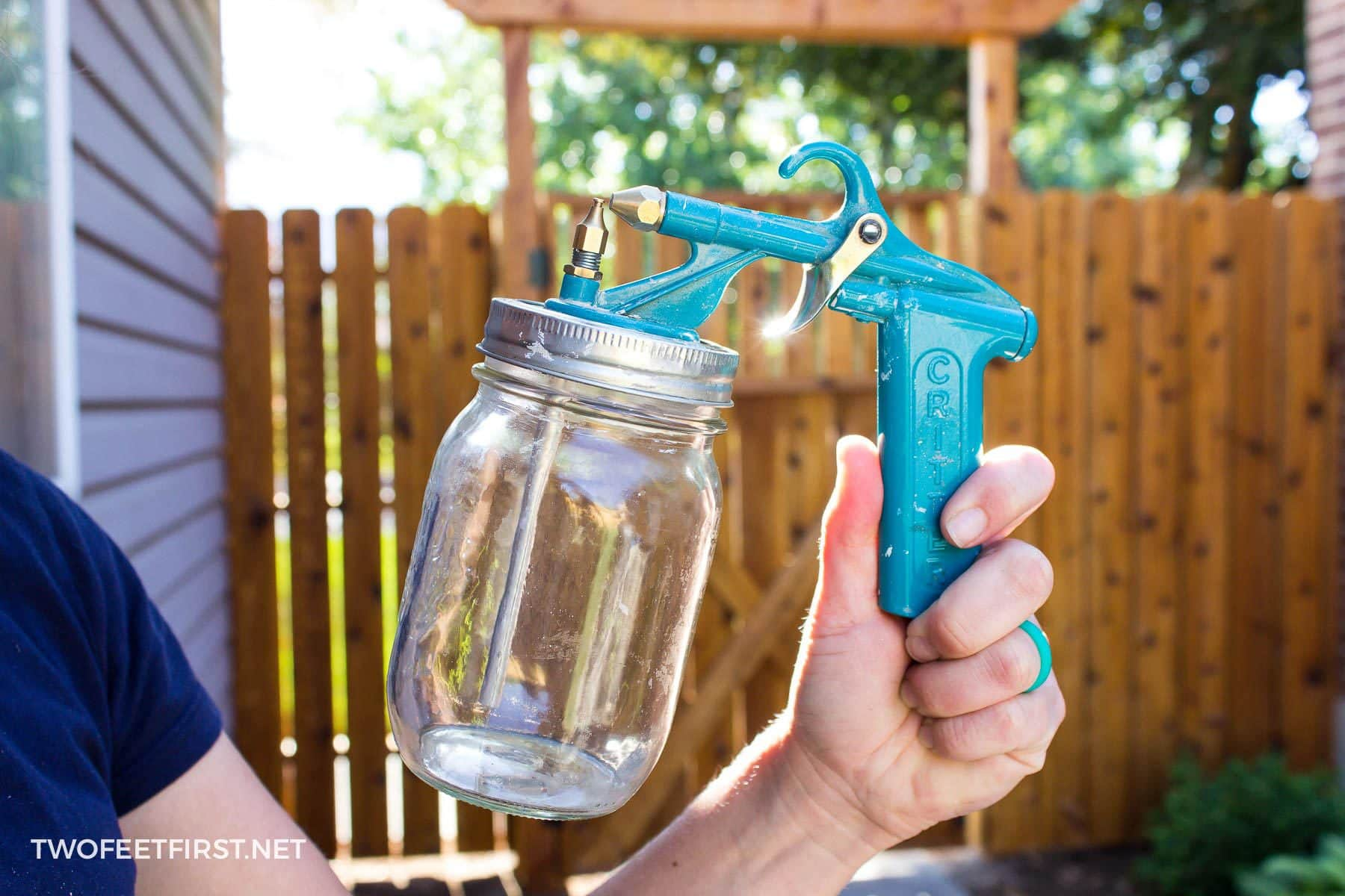 critter paint sprayer used to spray stain on fence