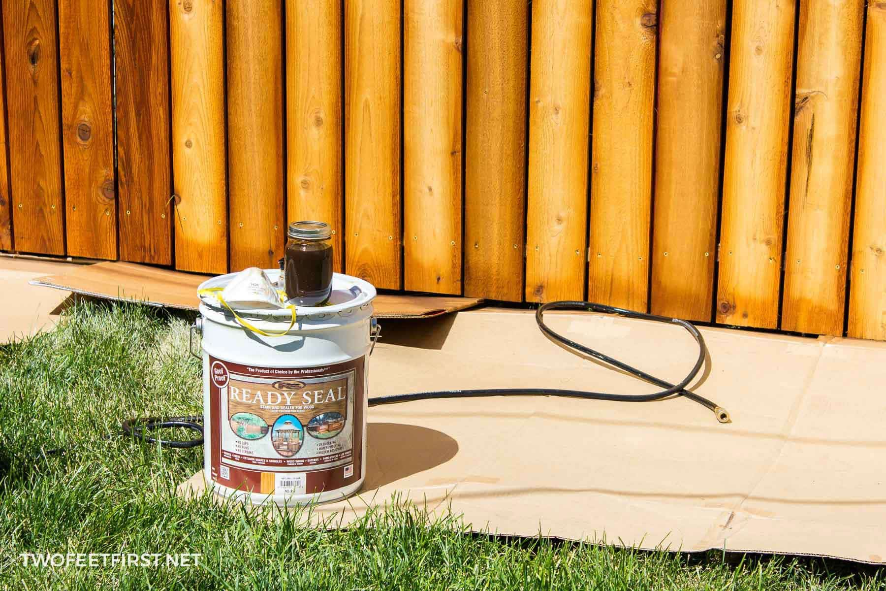 spray stain on fence
