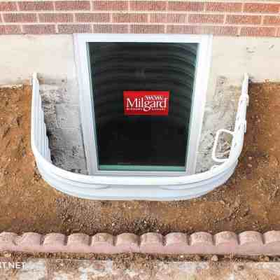 The process of installing window wells for a basement