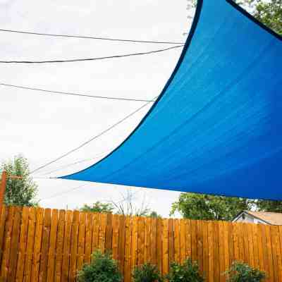 Installing Sun Sail Shade in a yard
