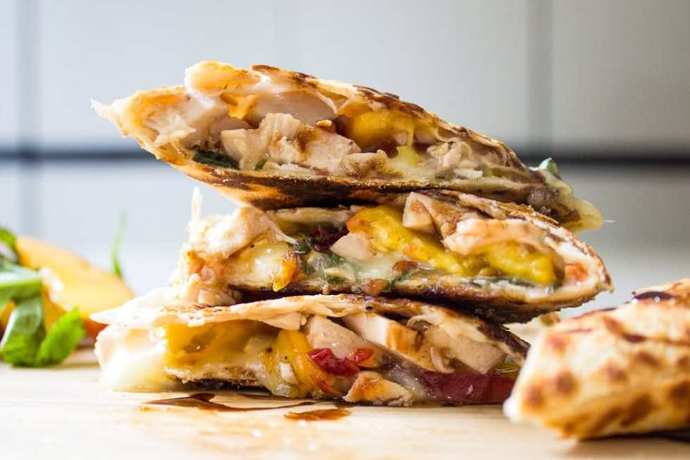 Peach, Chicken, Brie Quesadilla with spicy sweet chili sauce, basil and a balsamic glaze drizzle