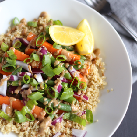 This Clean Protein Quinoa Bowl is packed with healthy protein and ingredients like carrots, green beans, onions and sweet almond maple dressing! Vegan - GF | TwoRaspberries.com