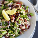 Easy Broccoli Salad with Almond Lemon Dressing- super healthy! broccoli, almonds, grapes, onions and almond butter lemon dressing! Quick to make. Vegan + GF | TwoRaspberries.com