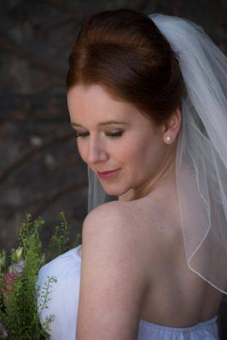 Bride outside LIchfield cathedral for wedding Staffordshire.