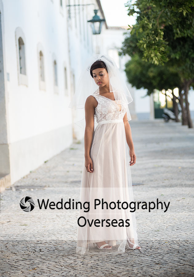 Bride posing for her photograph by weddings photographer at her destination wedding