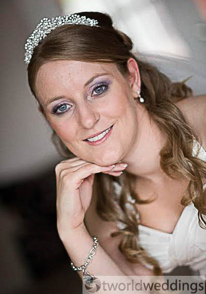 curly hair style and natural wedding make up for bride on her wedding day.BY make up artist at TWorld Weddings