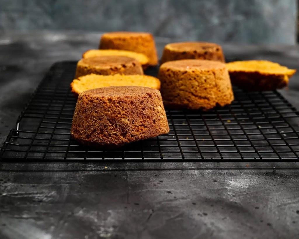 Mini cakes on black cooling rack