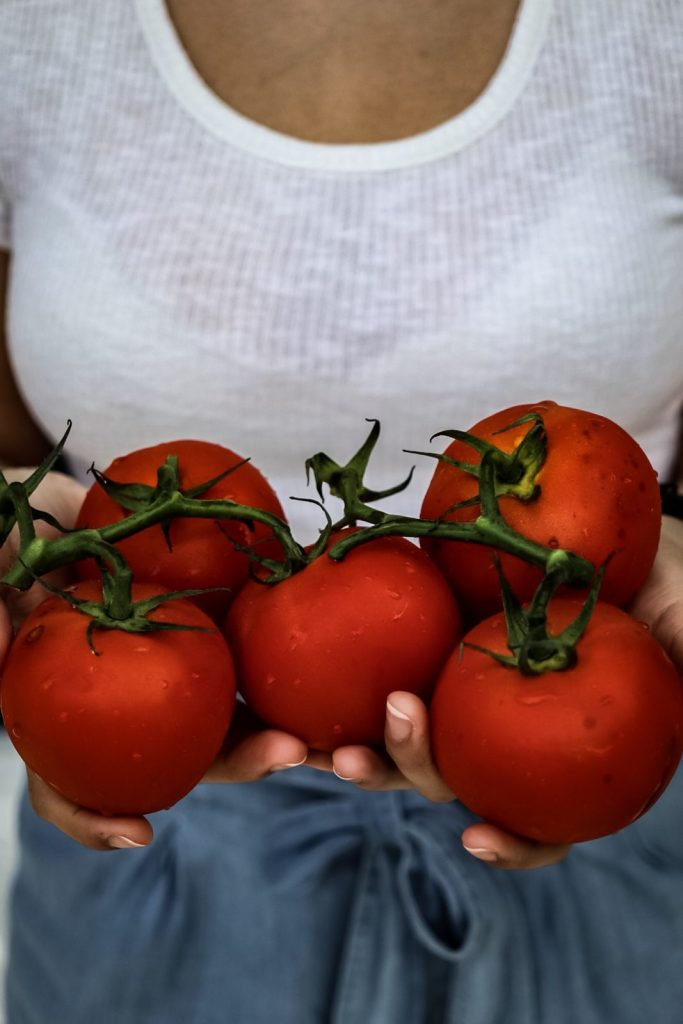 Tomatoes and hands