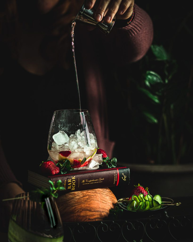 strawberry cucumber mojito, summer cocktail, light rum poured into the glass