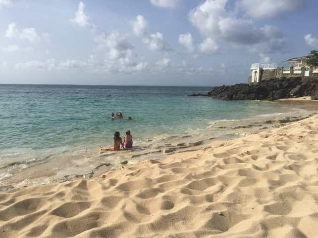 """Baie Rouge is one of our favorite beaches in St. Martin -""""Scam Alert: Massages at Baie Rouge Beach in St. Martin"""" - Two Traveling Texans"""