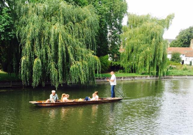 "Family punting on the Cam River - ""Punting in Cambridge, England – And I am not Talking about Football"" - Two Traveling Texans"