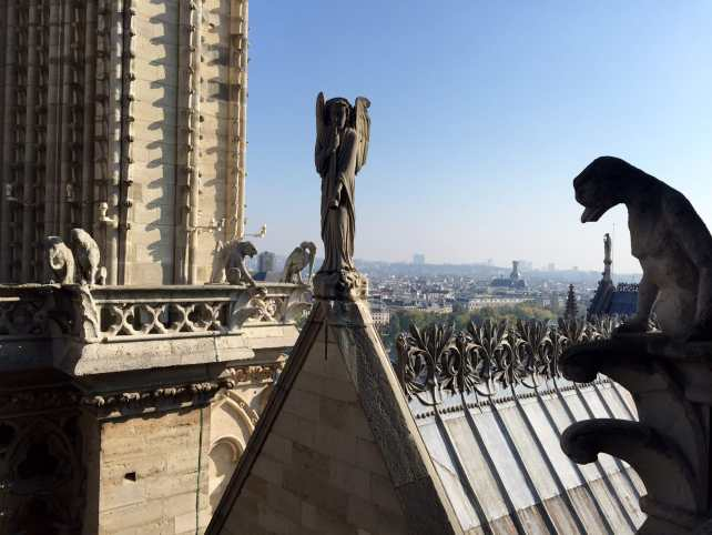 "Some gargoyles and the roof of other parts of the cathedral, plus view of Paris in the distance. - - ""Morning with Gargoyles at Notre Dame de Paris"" - Two Traveling Texans"