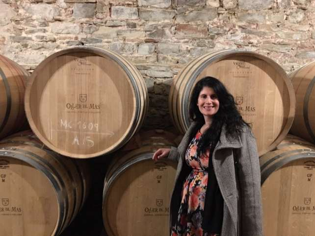 "Anisa with the barrels of wine at the Oller del Mas winery. - ""Montserrat: Mountain, Monastery, and Wine"" - Two Traveling Texans"