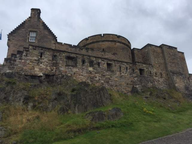 "Looking up towards the top section of Edinburgh Castle. - ""Experiencing History at Edinburgh Castle"" - Two Traveling Texans"
