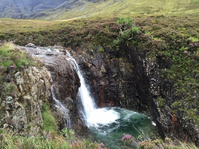 """The largest waterfall in the Fairy Pools was pretty impressive. - """"The Magical Fairy Pools in Isle of Skye, Scotland"""" - Two Traveling Texans"""
