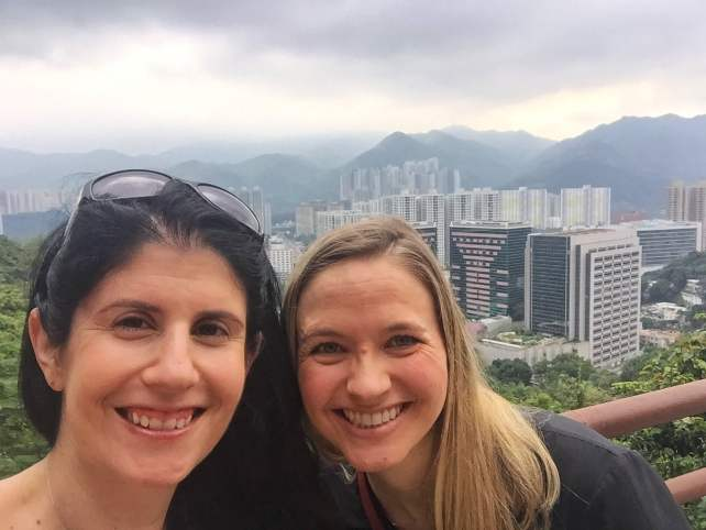 """Selfie with a view of Hong Kong in the background. Taken at the top level of the 10,000 Buddhas Monastery. - """"The Truth about the 10000 Buddhas Monastery"""" - Two Traveling Texans"""
