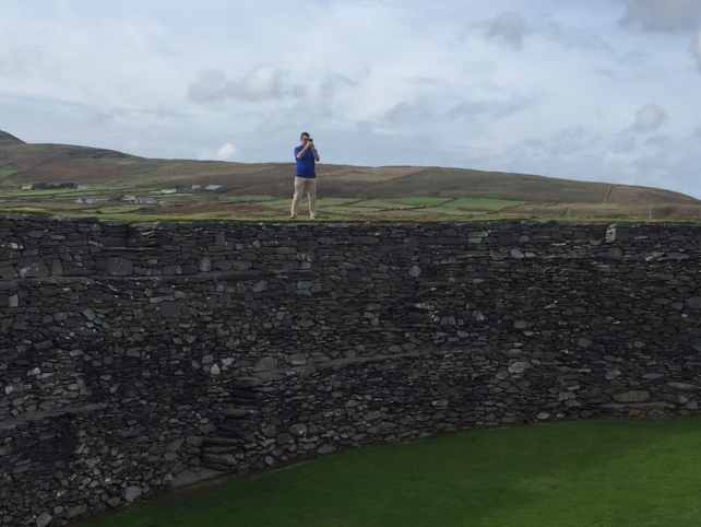 "Russell climbed the stone fort to get some pictures. - ""Why You Must Do the Ring of Kerry at Least Once in Your Lifetime"" - Two Traveling Texans"