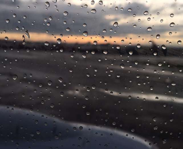 "A rainy sunset as seen from a plane at Newark Airport. - ""The Best Options for Traveling Between Manhattan and Newark Airport (EWR)"" - Two Traveling Texans"