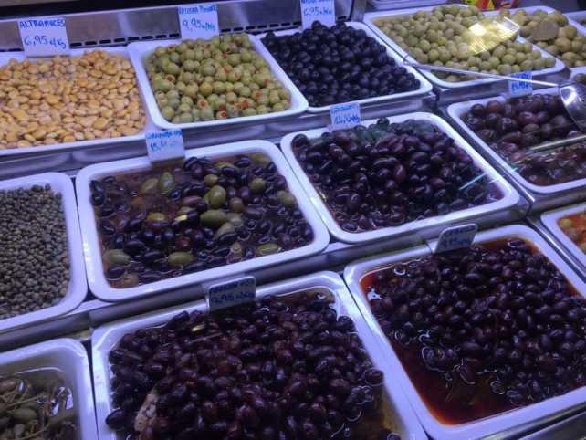 """A pretty impressive selection of olives at La Boqueria Market. - """"La Boqueria Market: Come Hungry!"""" - Two Traveling Texans"""