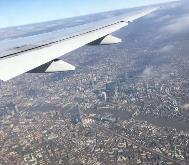 "I was able to get some great aerial shots of London thanks to my window seat and a clear day! - ""Neck Support Pillow and Other Travel Sleeping Tips"" - Two Traveling Texans"