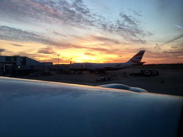 """Sunset at Heathrow Airport in London before the long flight back to New York City. - """"Neck Support Pillow and Other Travel Sleeping Tips"""" - Two Traveling Texans"""