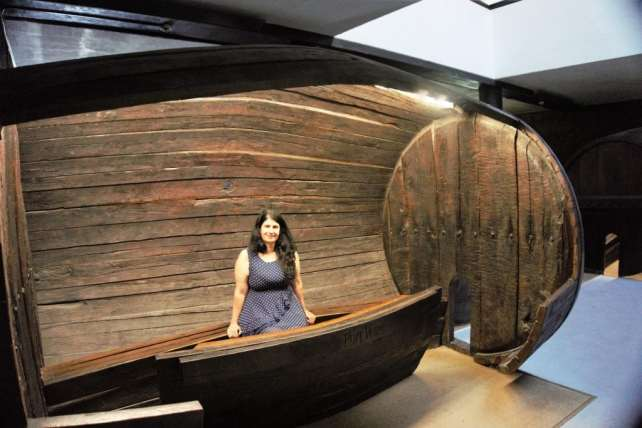 """Anisa having fun posing inside a port barrel at the Quevedo Port Wine House. - """"Port House Visits and Cable Cars"""" - Two Traveling Texans"""