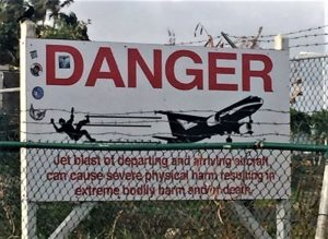 """The warning sign that so many beach goers disregard! - """"Maho Bay: Plane Spotting in St. Maarten"""" - Two Traveling Texans"""
