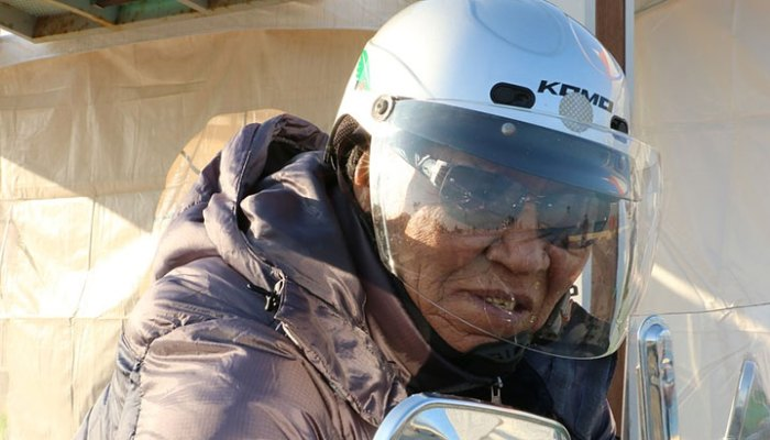 old guy in motorcycle helmet