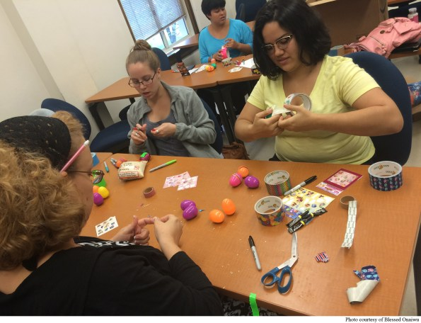 Student Association for Music Therapy members, Lara Jenks, Ashley Bray, Aspen Maxwell, and Nicasia Rivera make egg shakers for the students of Owina.