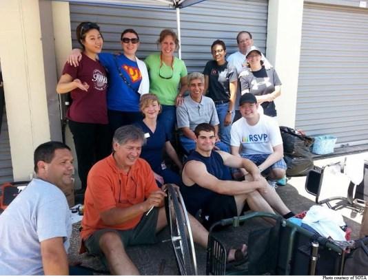 SOTA members and RSVP volunteers take a brief break while repairing equipment.