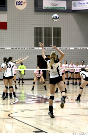 Outside Hitter Mallory Kuechle #1 serves the ball.