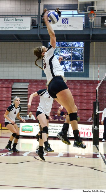 Middle Blocker Sara Oxford #5 makes an effort to spike the ball in the game against Midwestern State.