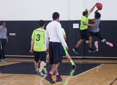 Several students participate in a spring 2015 intramurals game.