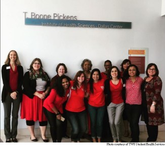 TWU Pioneers on the Dallas campus pose together to show support and raise awareness for Go Red for Women.