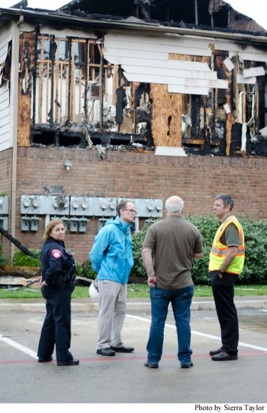 Campus and city officials discuss the damage caused by the fire.