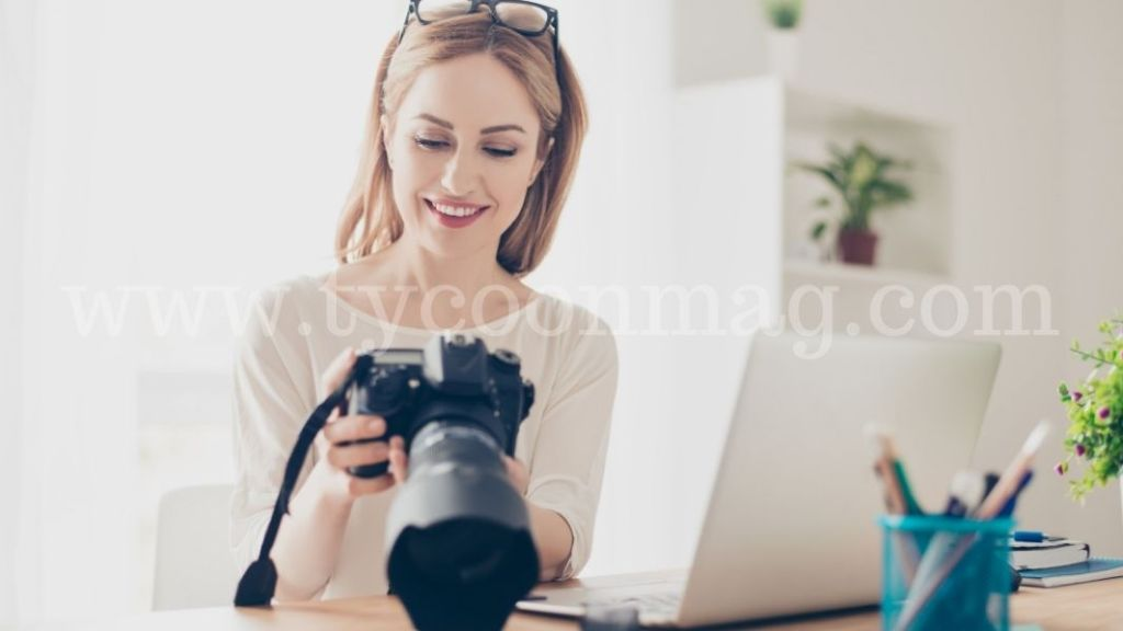 woman reviewing photos on camera