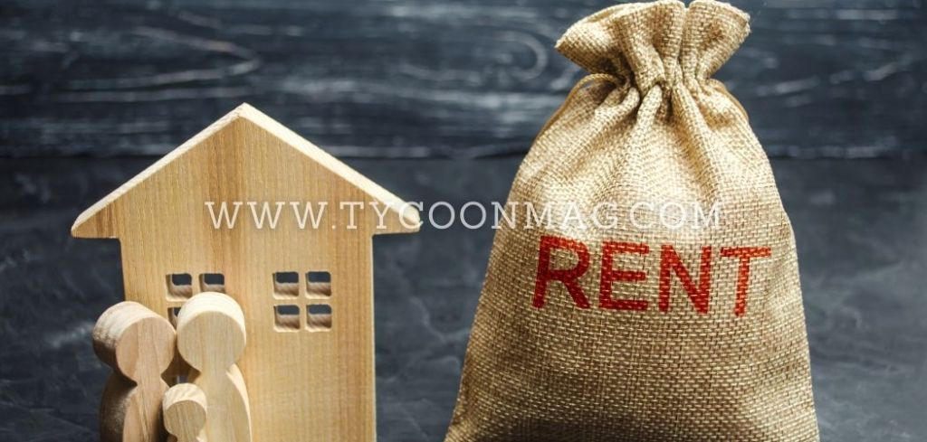 rental income money bag with wood house