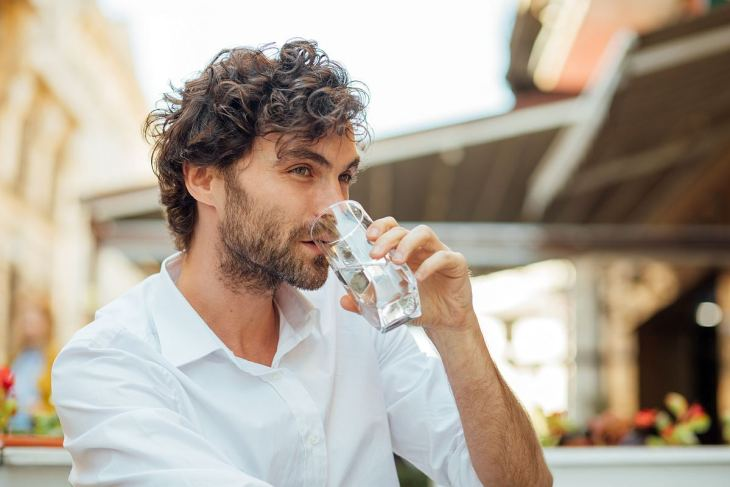 Young masculine man drinking water | Introducing Your Body To Alkaline Water | alkaline water benefits
