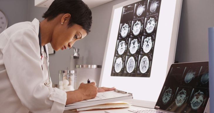 African medical woman reading x-ray results of a brain | Reasons to Love Tyent Water Ionizers, Part 8: Most Compelling Studies on Hydrogen-Rich Alkaline Water | hydrogen water