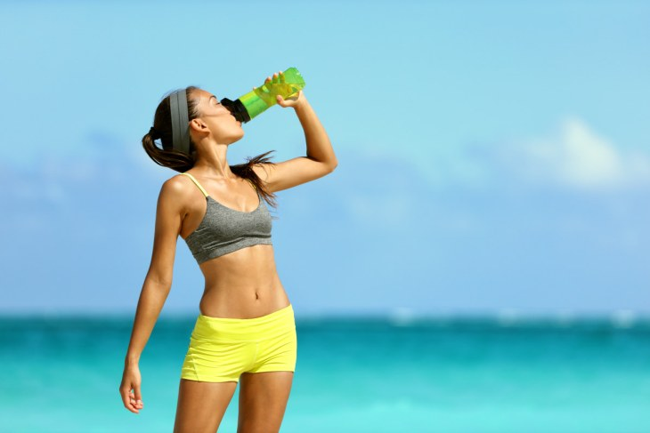 Fitness runner woman drinking water   Everything You Need To Know About Healthy Eating