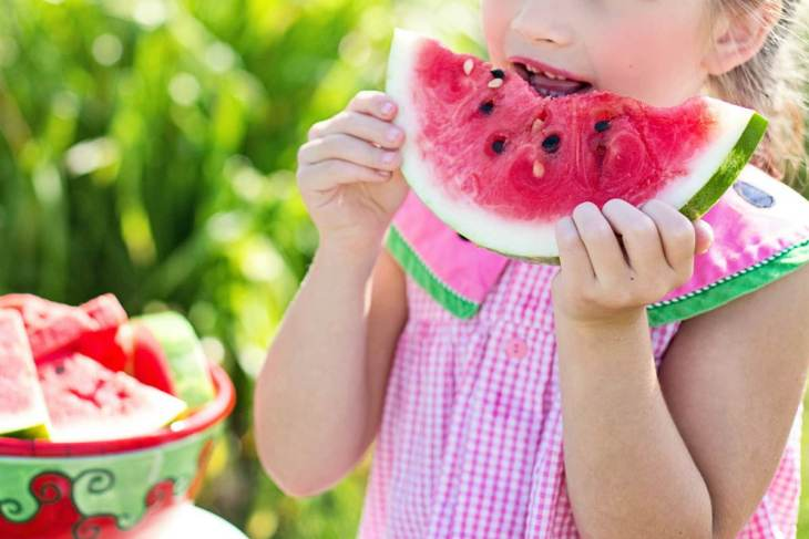 girl eating watermelon | Constipation In Children: 10 Alkaline Foods To Relieve It | chronic constipation in children