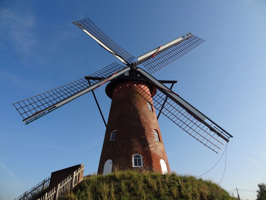 Looking up at a Belgian windmill
